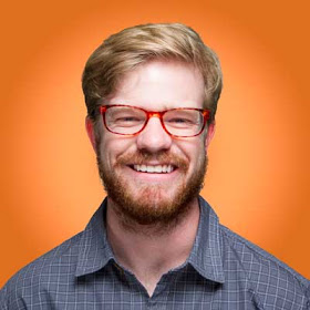headshot of jacob copple on an orange background